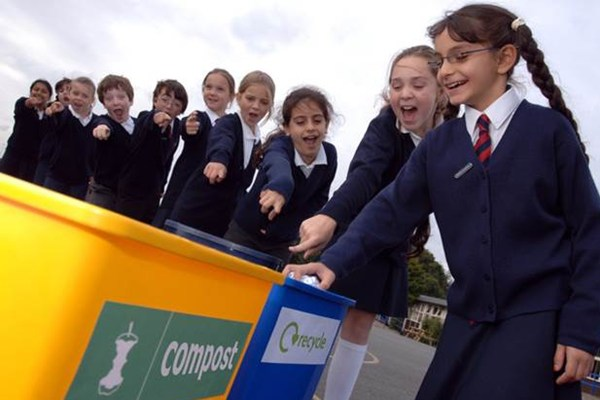 Kids putting rubbish into correct bin