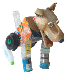 Rebel facing right, dog made of re-use materials, bottles, cardboard, cartons